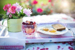 beautiful breakfast of eggs and toas laid out for a picnic in a sunny field