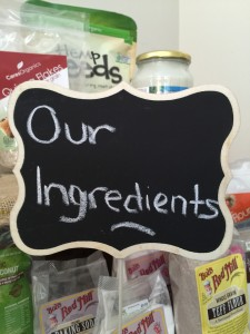 """a sign that reads """"our ingredients"""" with healthy food behind it"""